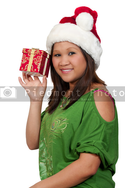 A beautiful young hispanic woman holding a Christmas present