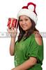 A beautiful young hispanic woman holding a Christmas present