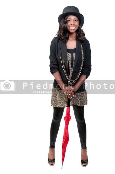 A beautiful young black African American teenegaer actress dancer wearing a top hat