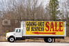A truck advertising a store that is Going Out of Business