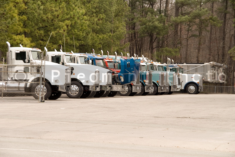 Large Tractor Trailors parked in a truck lot