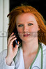 A beautiful young female doctor on the phone