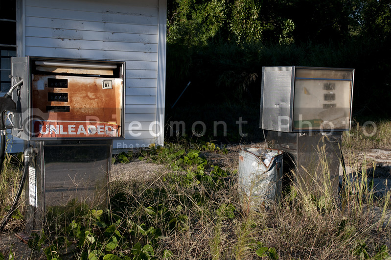 Run down gas pumps at an abandoned petrol station.