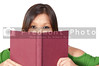A beautiful young hispanic woman reading a book
