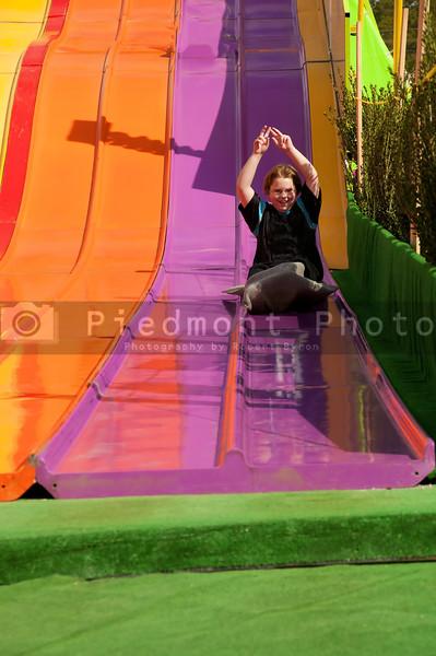 A boy on a giant carvival slide
