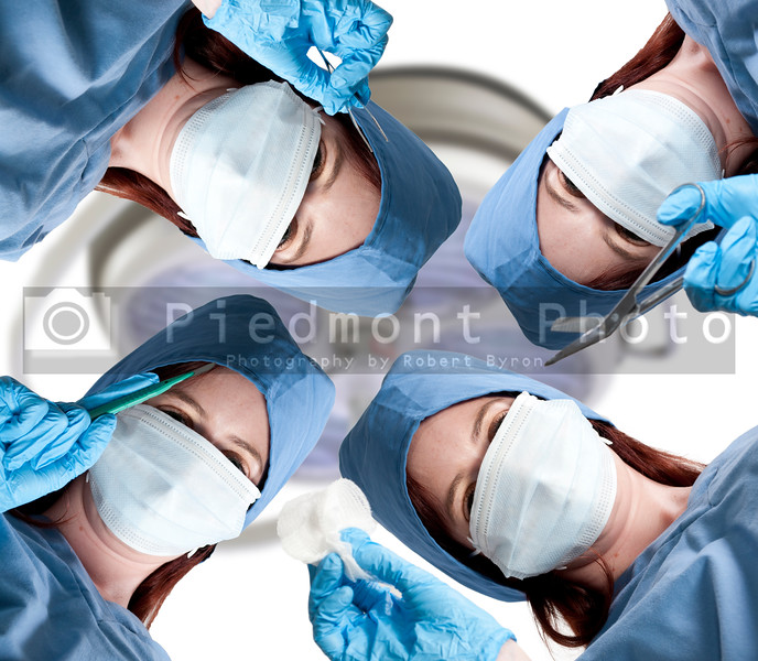 A beautiful young woman surgeon performing surgery