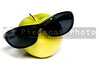 A close-up of a Granny Smith Applewith sunglasses