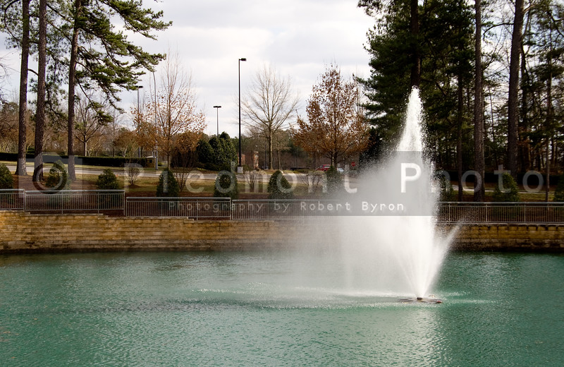 A fountain geyser in an outdoor pond