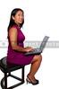 A beautiful computer savvy young woman using a laptop