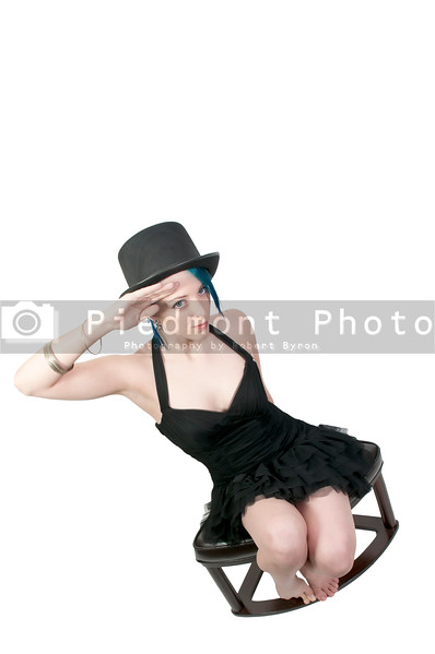 A beautiful young actress dancer wearing a top hat