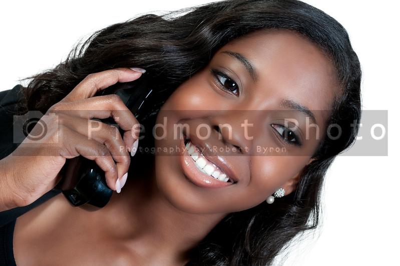 An African American teenage woman talking on the phone