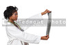 A beautiful woman doctor radiologist in a lab coat holding an x-ray