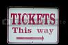 A sign with the words Tickets This Way