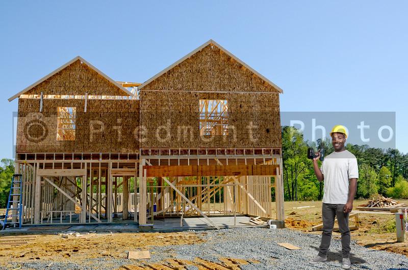 A black man African American construction worker a job site.