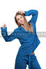 A young stretching woman waking up in her pajamas in the morning