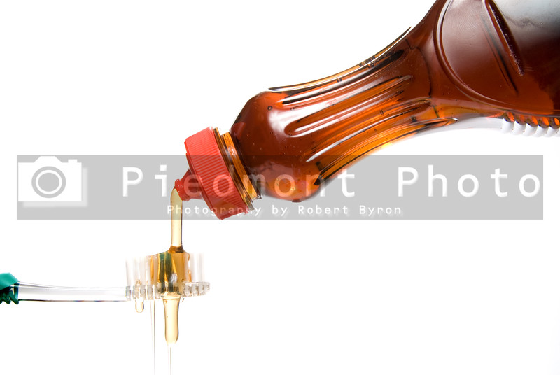 Maple Syrup Pouring Over a Tooth Brush