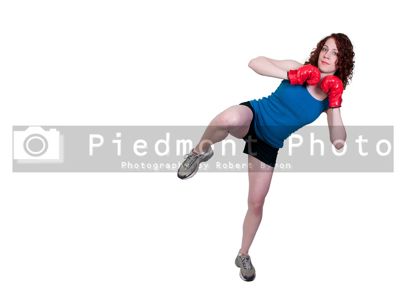 A beautiful young woman practicing martial arts kickboxing