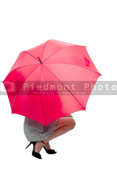 A beautiful woman holding a colorful umbrella