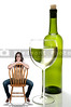 A beautiful  woman with a wine bottle and glass