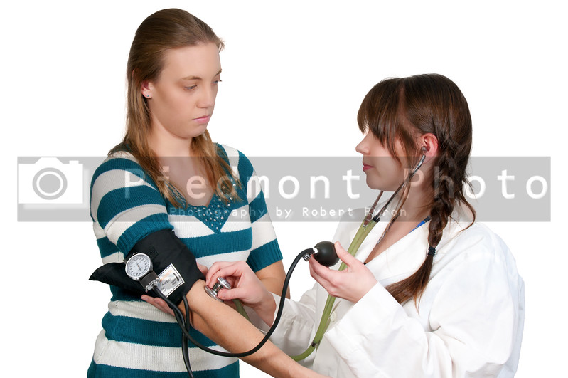 A woman doctor checking a patient blood pressure