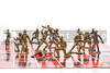A set of plastic toy soldiers playing chess.
