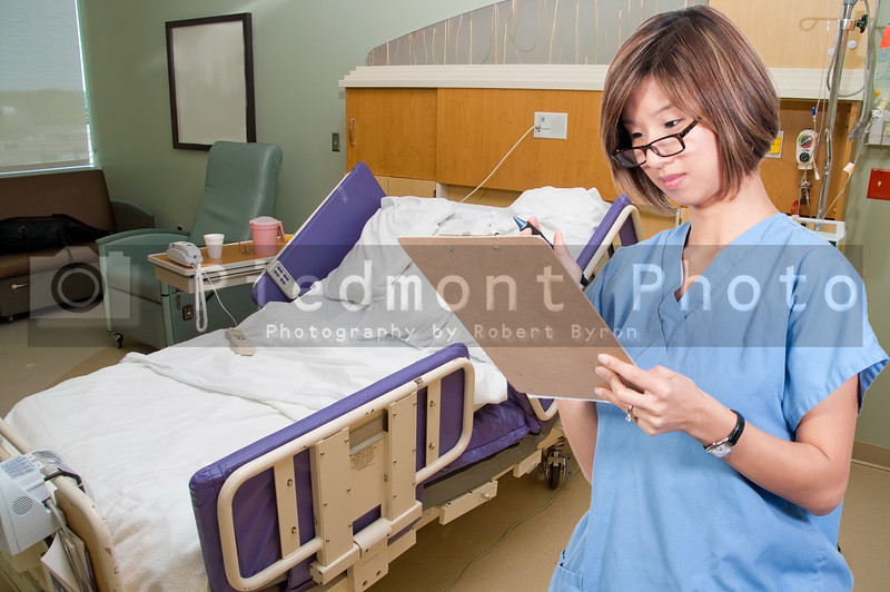 A beautiful young female Asian doctor on her rounds