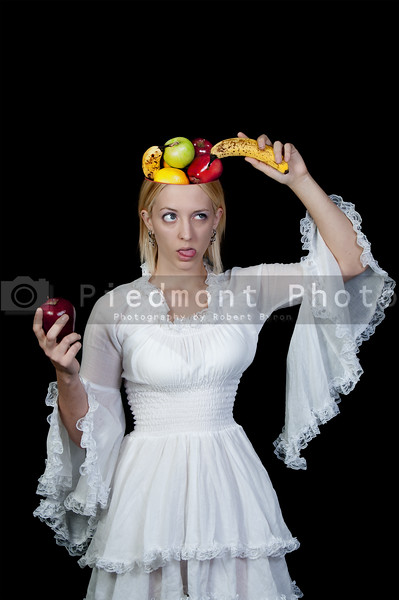 A woman with a fruit bowl head