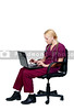 A beautiful young female doctor using a computer