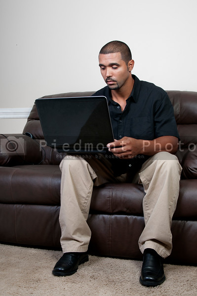 A middle aged man using a computer