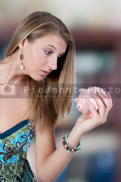 A beautiful woman holding a piggy bank full of money she has saved