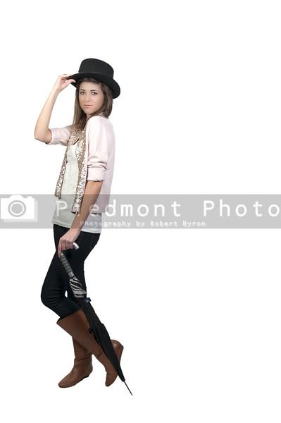 A beautiful young actress dancer wearing a top hat