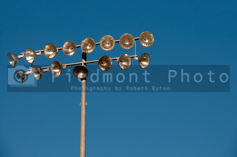 A set of stadium lights over a sports field