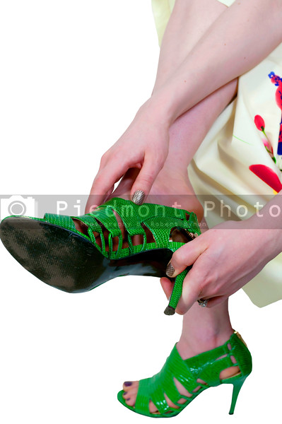 A beautiful young woman putting on her shoes