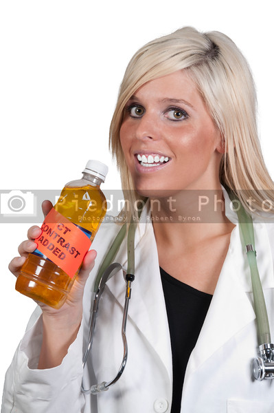 A beautiful doctor holding a bottle of CT contrast