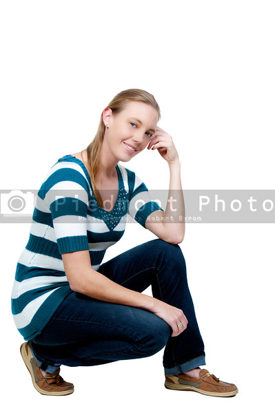 A beautiful young woman sitting on the floor