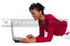 A black woman college student working on a laptop
