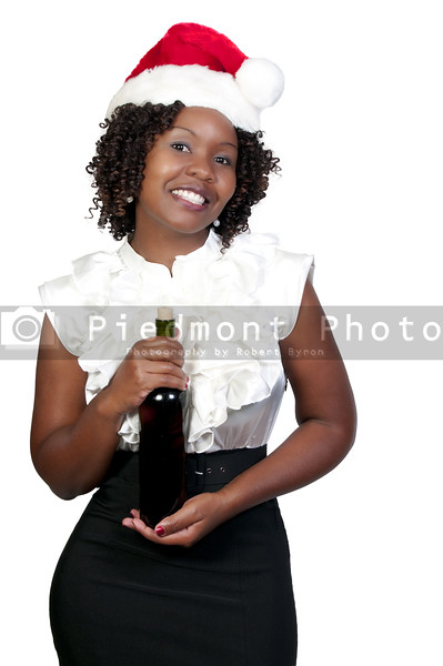 A black woman with wine wearing a Santa hat
