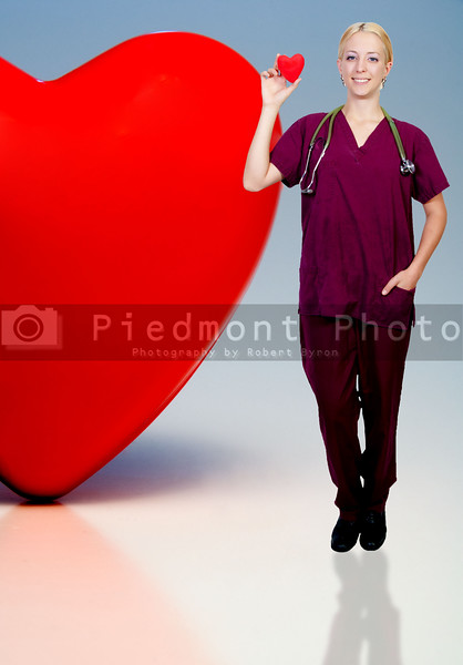 A female doctor woman cardiologist holding a red heart