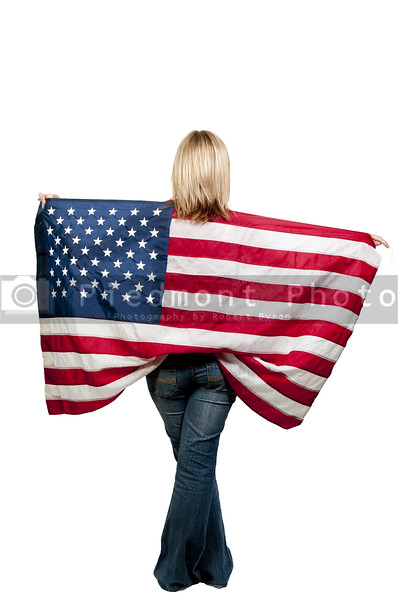 A beautiful young woman holding an American flag.