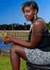 A very beautiful African American black woman sitting near a lake