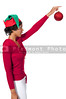 A beautiful young black woman holding or hanging a Christmas ornament