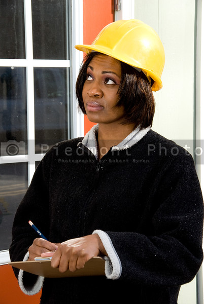 A female Construction Inspector checking the integrity of a building