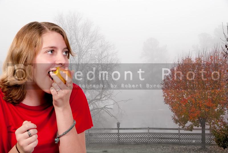 A beautiful teenage girl eating a peach