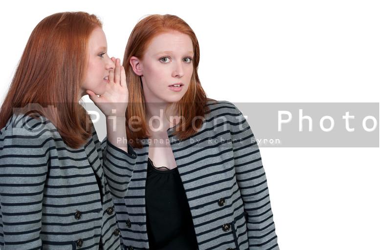 A young beautiful woman whispering a secret