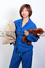 A beautiful woman in pajamas holding a Teddy Bear