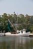 A commercial shrimp boat docked at the ocean