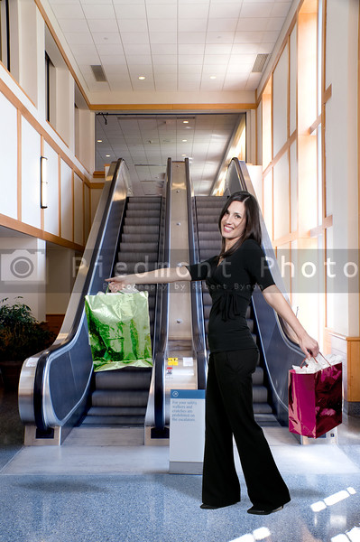 A bank of moving escalators in a building.
