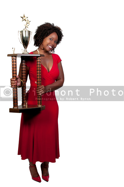 A beautiful woman holding a large trophy