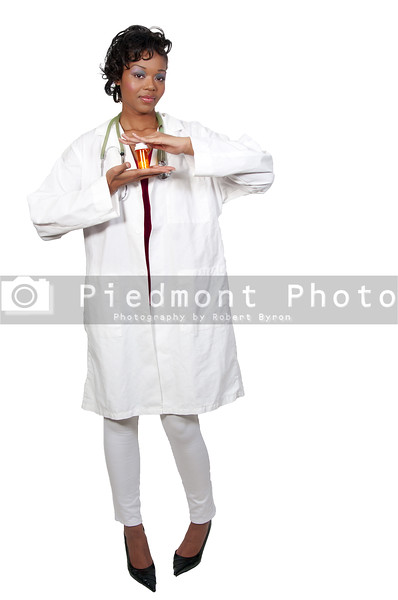 An black woman doctor holding a bottle of prescription pills in a bottle