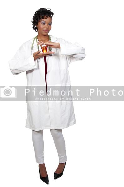 An black woman doctor holding a bottle of prescription pills in a bottle